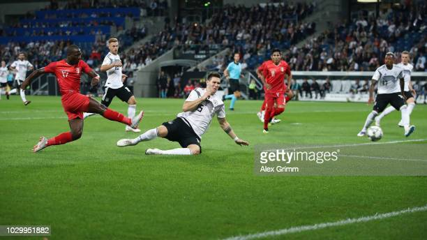 Luis Advincula of Peru scores his team's first goal against Niklas Suele of Germany during the International Friendly match between Germany and Peru...
