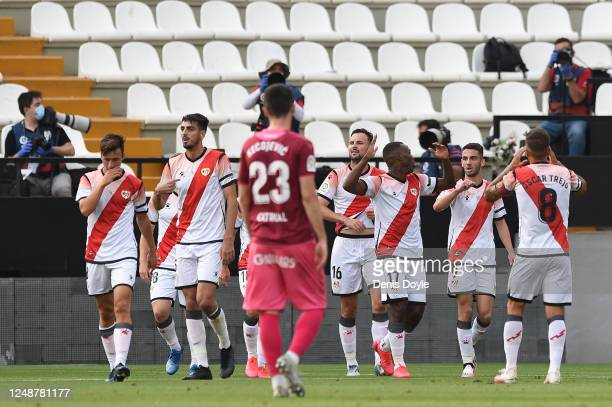 Luis Advincula of Rayo Vallecano celebrates with his team mates after scoring his team's first goal during the La Liga SmartBank match between Rayo...