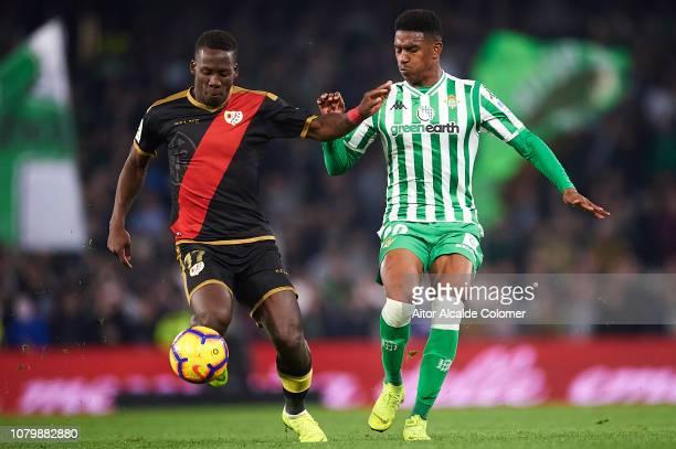 Luis Advincula of Rayo Vallecano competes for the ball with Junior Firpo of Real Betis Balompie during the La Liga match between Real Betis Balompie...