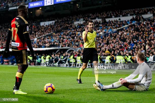 Luis Advincula of Rayo Vallecano De Burgos Bengoetxea referee Toni Kroos of Real Madrid during the La Liga Santander match between Real Madrid v Rayo...