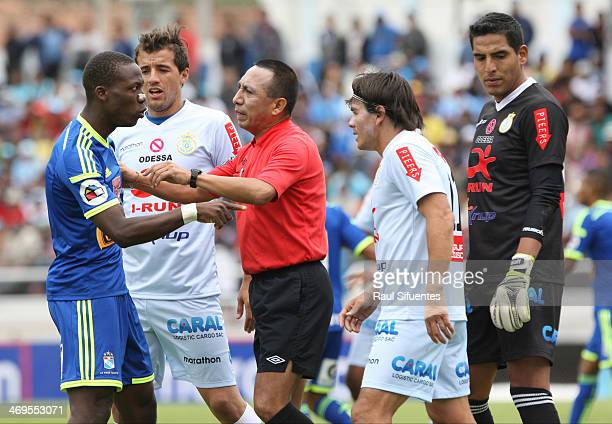 Luis Advincula of Sporting Cristal discusses with referee Freddy Arellano during a match between Real Garcilaso and Sporting Cristal as part of the...