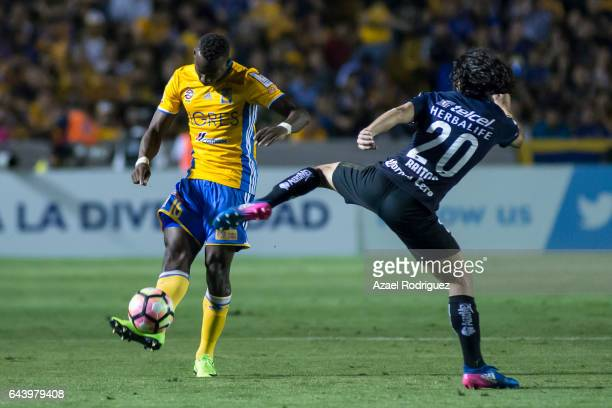 Luis Advincula of Tigres fights for the ball with Matias Britos of Pumas during the quarterfinals first leg match between Tigres UANL and Pumas UNAM...