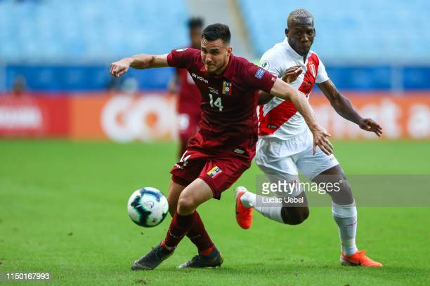 Luis Advíncula of Peru battles for the ball against Luis Mago of Venezuela during the Copa America Brazil 2019 Group A match between Venezuela and...