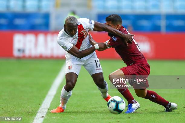Luis Advíncula of Peru battles for the ball against Tomás Rincón of Venezuela during the Copa America Brazil 2019 Group A match between Venezuela and...