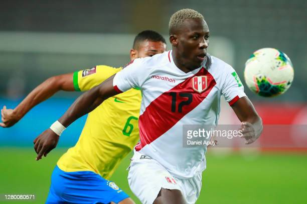 Luis Advíncula of Peru eyes the ball during a match between Peru and Brazil as part of South American Qualifiers for Qatar 2022 at Estadio Nacional...