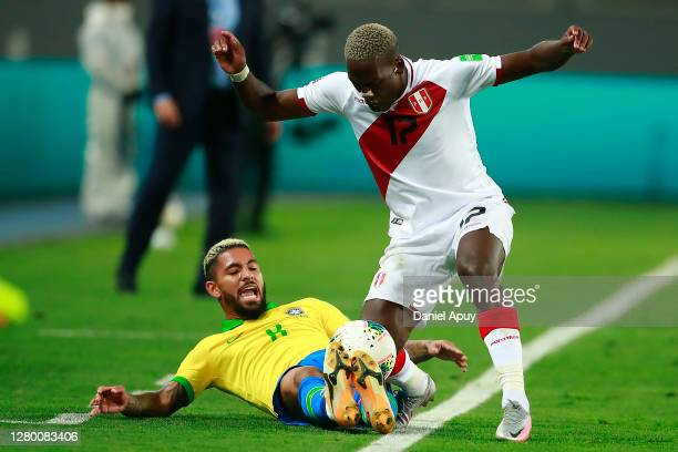 Luis Advíncula of Peru fights for the ball with Douglas Luiz of Brazil during a match between Peru and Brazil as part of South American Qualifiers...