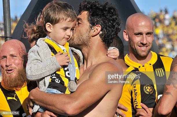 Luis Aguiar of Peñarol celebrates with his son after winning a match between Peñarol and Juventud as part of Torneo Apertura 2015 at Centenario...