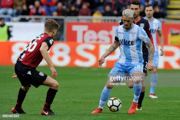 Luis Albertio of SS Lazio competes for the ball with Filippo Romagna of Cagliari Calcio during the serie A match between Cagliari Calcio and SS Lazio...