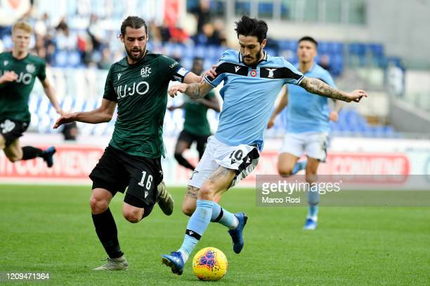 Luis Alberto o of SS Lazio compete for the ball with Andrea Poli during the Serie A match between SS Lazio and Bologna FC at Stadio Olimpico on...