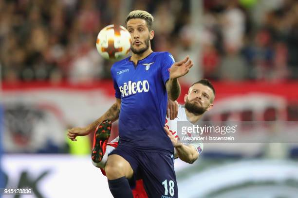 Luis Alberto of Lazio battles for the ball with Valon Berisha of Salzburg during the UEFA Europa League quarter final leg two match between RB...
