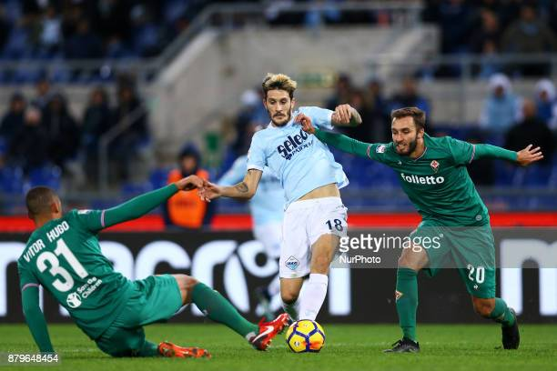 Luis Alberto of Lazio between Vitor Hugo and German Pezzella of Fiorentina during the Italian Serie A football match Lazio vs Fiorentina at the...