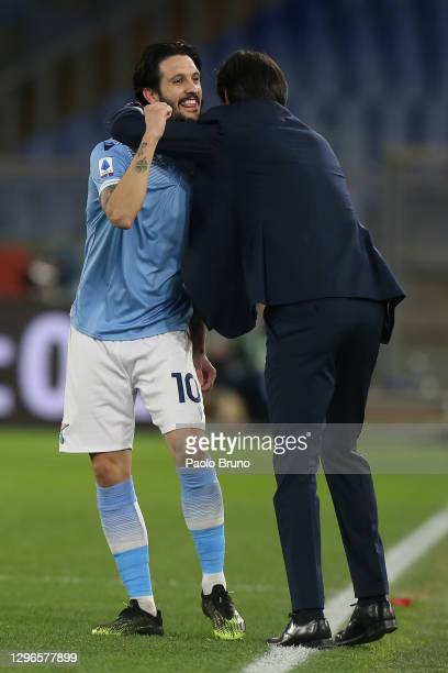 Luis Alberto of Lazio celebrates with coach Simone Inzaghi after scoring his team's third goal during the Serie A match between SS Lazio and AS Roma...