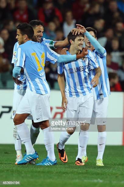 Luis Alberto of Malaga celebrates with teammate after he scored a goal during the international club friendly match between Adelaide United and...