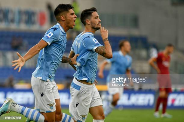 Luis Alberto of SS Lazio celebrate a first goal with his team mates during the Serie A match between SS Lazio and AS Roma at Stadio Olimpico on...