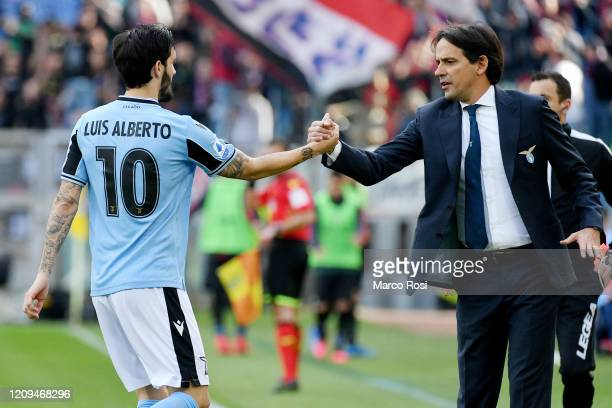Luis Alberto of SS Lazio celebrate a opening goal with SS Lazio head coach Simone Inzaghi during the Serie A match between SS Lazio and Bologna FC at...