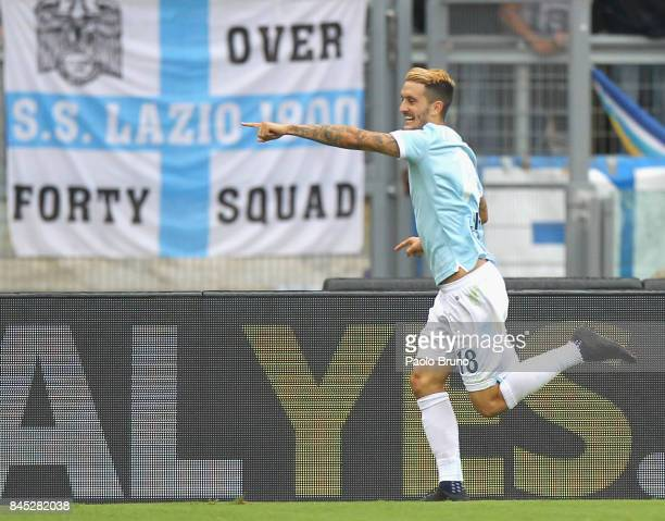 Luis Alberto of SS Lazio celebrates after scoring the team's fourth goal as AC Milan players react during the Serie A match between SS Lazi o and AC...