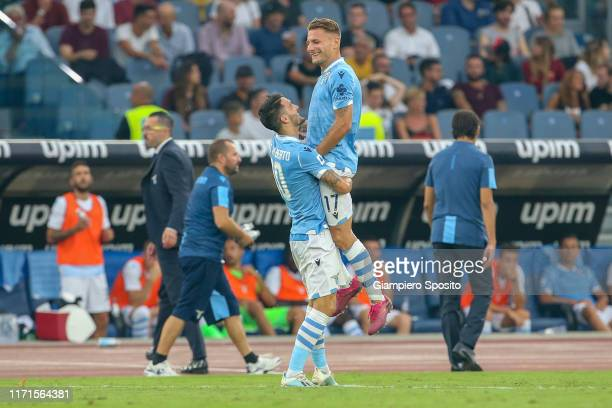 Luis Alberto of SS Lazio celebrates with Ciro Immobile after scoring a goal during the Serie A match between SS Lazio and AS Roma at Stadio Olimpico...