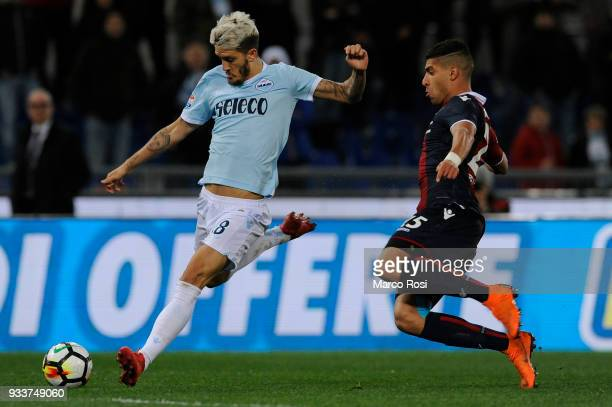 Luis Alberto of SS Lazio compete for the ball with Adam Masina of Bologna FC during the serie A match between SS Lazio and Bologna FC at Stadio...