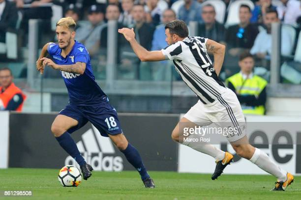 Luis Alberto of SS Lazio compete for the ball with Andrea Barzagli of Juventus during the Serie A match between Juventus and SS Lazio on October 14...