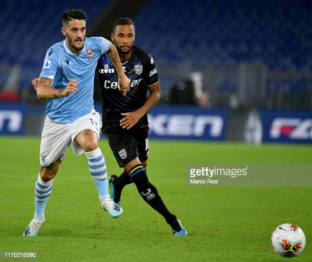 Luis Alberto of SS Lazio compete for the ball with Azvedo Junior Hernani of Parma Calcio during the Serie A match between SS Lazio and Parma Calcio...