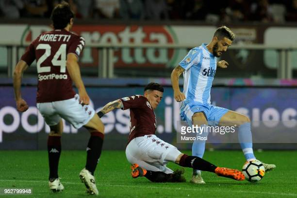 Luis Alberto of SS Lazio compete for the ball with Daniele Baselli of Torino FC during the serie A match between Torino FC and SS Lazio at Stadio...