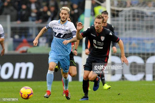 Luis Alberto of SS Lazio compete for the ball with Filip Bradaric of Cagliari during the Serie A match between SS Lazio and Cagliari at Stadio...