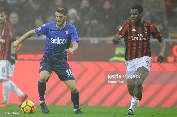 Luis Alberto of SS Lazio compete for the ball with Frack Kessie of AC Milan during the serie A match between AC Milan and SS Lazio at Stadio Giuseppe...