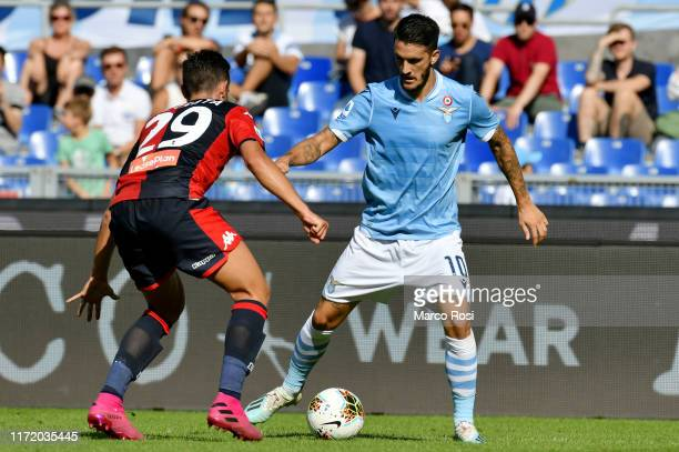 Luis Alberto of SS Lazio compete for the ball with Francesco Cassata during the Serie A match between SS Lazio and Genoa CFC at Stadio Olimpico on...