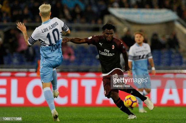 Luis Alberto of SS Lazio compete for the ball with Franck Kessie of AC MIlan during the Serie A match between SS Lazio and AC Milan at Stadio...