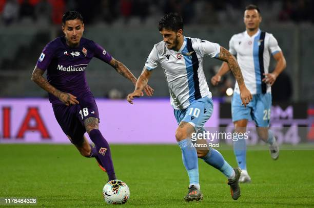Luis Alberto of SS Lazio compete for the ball with German Pezzella of Fiorentina ACF during the Serie A match between ACF Fiorentina and SS Lazio at...
