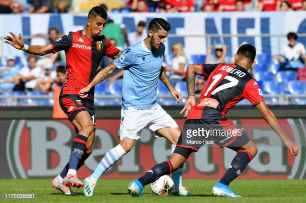 Luis Alberto of SS Lazio compete for the ball with Jawad El Yamiq during the Serie A match between SS Lazio and Genoa CFC at Stadio Olimpico on...