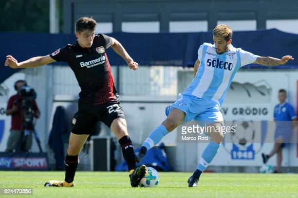 Luis Alberto of SS Lazio compete for the ball with Kai Havertz of Bayer Leverkusen during the preseason friendly match between SS Lazio and Bayer...
