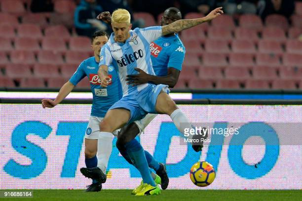Luis Alberto of SS Lazio compete for the ball with Kalidou Koulibaly of SSC Napoli during the serie A match between SSC Napoli and SS Lazio at Stadio...