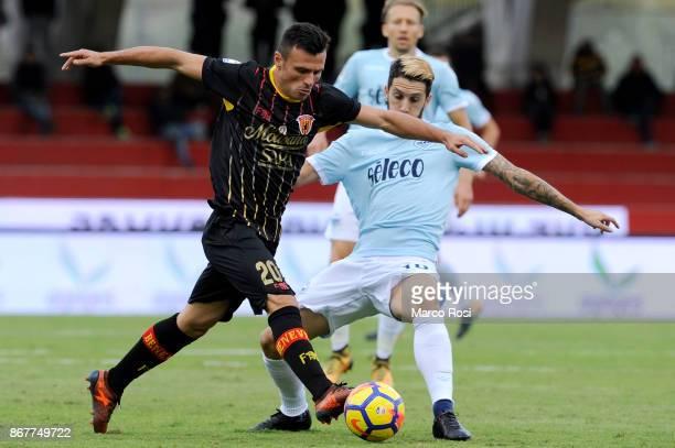 Luis Alberto of SS Lazio compete for the ball with Lediam Memushaj of Benevneto Calcio during the Serie A match between Benevento Calcio and SS Lazio...