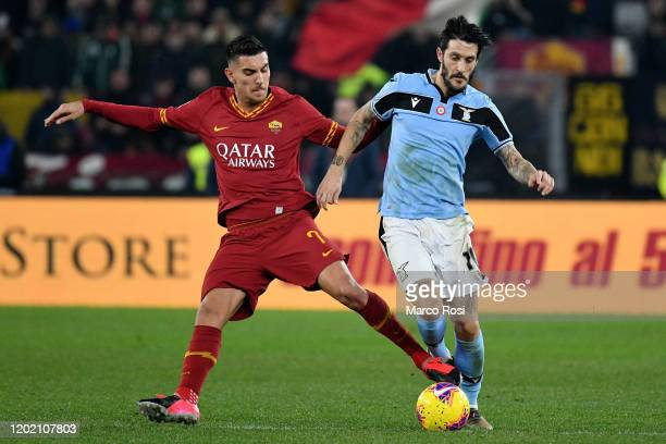Luis Alberto of SS Lazio compete for the ball with Lorenzo Pellegrini of AS Roma during the Serie A match between AS Roma and SS Lazio at Stadio...