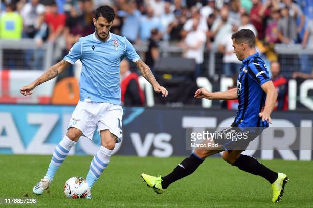 Luis Alberto of SS Lazio Compete for the ball with Remo Freuler of Atalanta BC during the Serie A match between SS Lazio and Atalanta BC at Stadio...