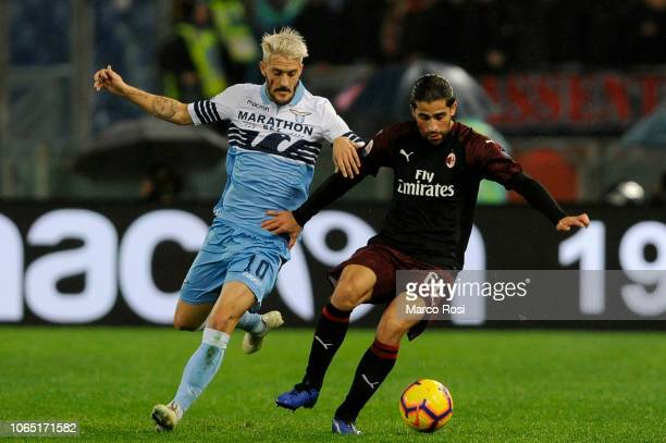 Luis Alberto of SS Lazio compete for the ball with Ricardo Rodriguez of AC MIlan during the Serie A match between SS Lazio and AC Milan at Stadio...