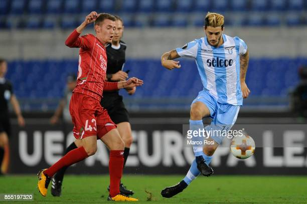 Luis Alberto of SS Lazio compete for the ball with Sander Coopman of SV Zulte Waregem during the UEFA Europa League group K match between SS Lazio...