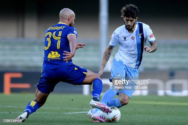 Luis Alberto of SS Lazio compete for the ball with Sofyan Amrabat of Hellas Verona during the Serie A match between Hellas Verona and SS Lazio at...