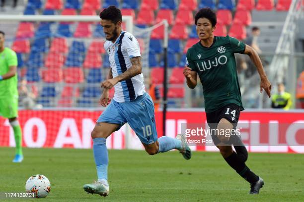 Luis Alberto of SS Lazio compete for the ball with Takehiro Tomiyasu of Bologna FC during the Serie A match between Bologna FC and SS Lazio at Stadio...