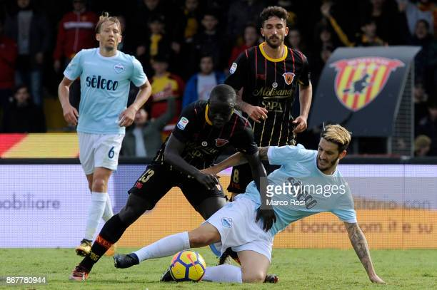 Luis Alberto of SS Lazio compete for the ball with Yusseif Chibsah of Benevneto Calcio during the Serie A match between Benevento Calcio and SS Lazio...