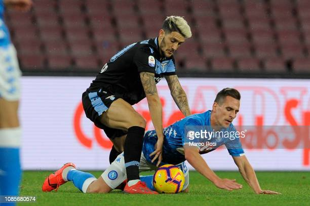 Luis Alberto of SS Lazio compete fot the ball with Arcadius Milik of SSC Napoli during the Serie A match between SSC Napoli and SS Lazio at Stadio...