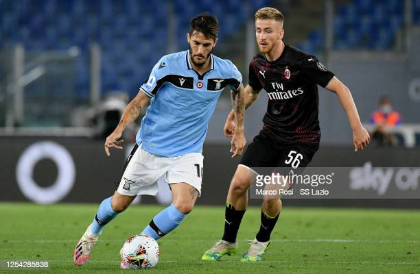 Luis Alberto of SS Lazio competes for the ball with Alexis Saelemaekers of AC Milan during the Serie A match between SS Lazio and AC Milan at Stadio...