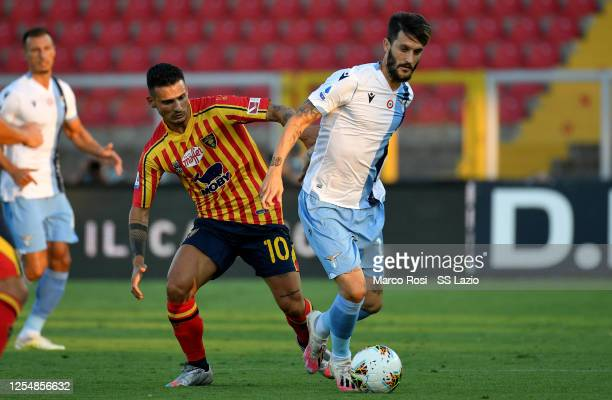 Luis Alberto of SS Lazio competes for the ball with Falco during the Serie A match between US Lecce and SS Lazio at Stadio Via del Mare on July 07...