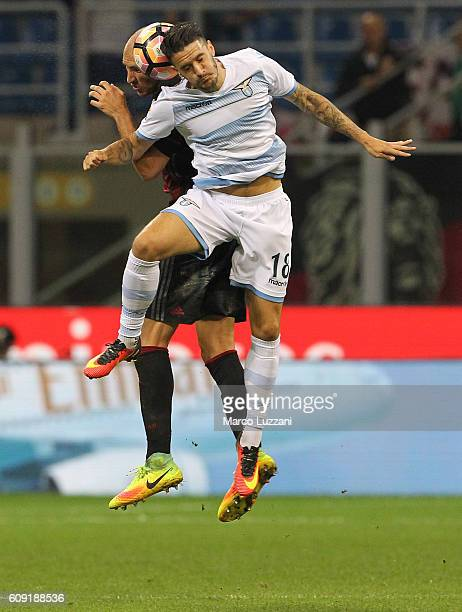 Luis Alberto of SS Lazio competes for the ball with Gabriel Paletta of AC Milan during the Serie A match between AC Milan and SS Lazio at Stadio...