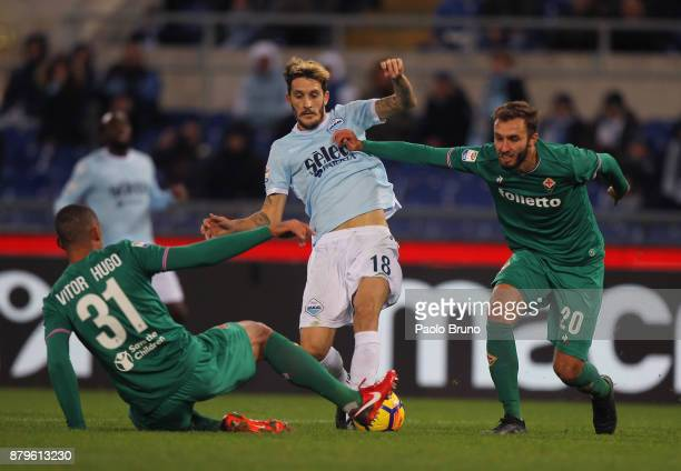 Luis Alberto of SS Lazio competes for the ball with German Pezzella and Vitor Hugo of ACF Fiorentina during the Serie A match between SS Lazio and...