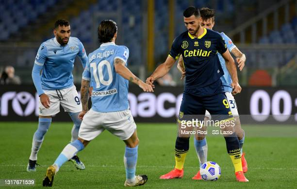 Luis Alberto of SS Lazio competes for the ball with Graziano Pellè of Parma Calcio during the Serie A match between SS Lazio and Parma Calcio at...
