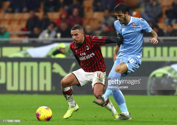 Luis Alberto of SS Lazio competes for the ball with Ismael Bennacer of AC Milan during the Serie A match between AC Milan and SS Lazio at Stadio...