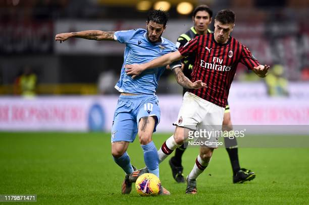 Luis Alberto of SS Lazio competes for the ball with Krzysztof Piatek of AC Milan during the Serie A football match between AC Milan and SS Lazio SS...