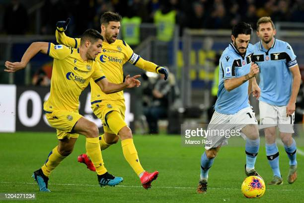 Luis Alberto of SS Lazio competes for the ball with Miguel Veloso of Hellas Verona during the Serie A match between SS Lazio and Hellas Verona at...